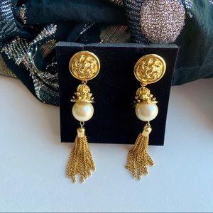 Long gold tone pearl tassel earrings